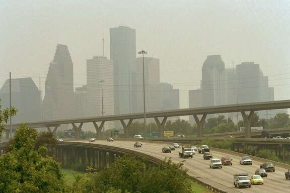 CONTACT FILED:  HOUSTON, TEXAS-SKYLINE Hazy skies envelope the Houston skyline on 9-13-02.     HOUCHRON CAPTION (11/16/2002):  Houston commuters contend with traffic as a murky layer of smog looms overhead in September. The Bayou City came in third for America's smoggiest city as unusually rainy and windy conditions in 2002 decreased ground-level ozone.     HOUCHRON CAPTION (01/27/2003): Commuters contend with traffic as haze envelops the city's skyline. Houston came in third in 2002 for America's smoggiest city.     HOUCHRON CAPTION (08/20/2003): Houston ranked ninth out of 50 major metropolitan areas for the number of days in 2000-2002 when air quality was unhealthy.     HOUCHRON CAPTION (02/22/2005) SECMETRO COLORFRONT:  Houston is still years away from reaching its goal of meeting a federal ozone standard deadline.     HOUCHRON CAPTION (02/22/2005) SECMETRO:  LONG FIGHT: More than three decades since the first deadline to meet a federal ozone standard, Houston is still years away from meeting that goal, as shown in this September 2002 photo of haze enveloping the city skyline. A recent Rice University research paper chronicles the process.