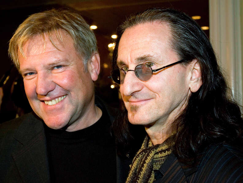 FILE - Alex Lifeson, left, and Geddy Lee of the rock band RUSH arrive for the Canadian Music Industr