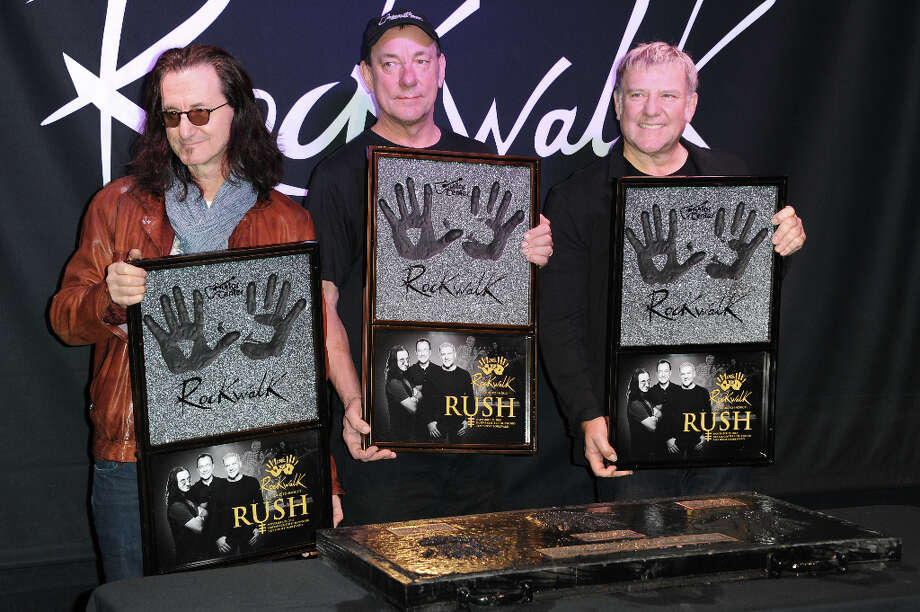 From left, Geddy Lee, Neil Peart, and Alex Lifeson attend the RockWalk induction of Rush at Guitar Center on Tuesday, Nov. 20, 2012, in Los Angeles. Photo: Richard Shotwell, Richard Shotwell/Invision/AP / Invision