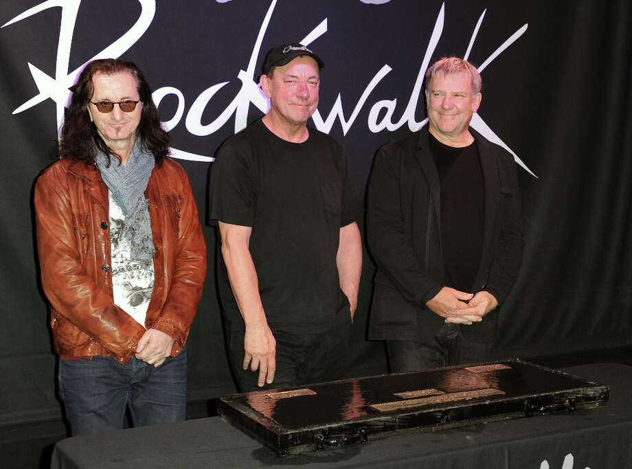 FILE - This Nov. 20, 2012 file photo shows members of the band Rush, from left, Geddy Lee, Neil Peart, and Alex Lifeson at the RockWalk induction of Rush at Guitar Center in Los Angeles. The eclectic group of rockers Rush and Heart, rappers Public Enemy, songwriter Randy Newman, Queen of Disco Donna Summer and bluesman Albert King will be inducted into the Rock and Roll Hall of Fame next April in Los Angeles. The inductees were announced Tuesday by 2012 inductee Flea of The Red Hot Chili Peppers at a news conference in Los Angeles. Photo: Richard Shotwell, Richard Shotwell/Invision/AP / Invision