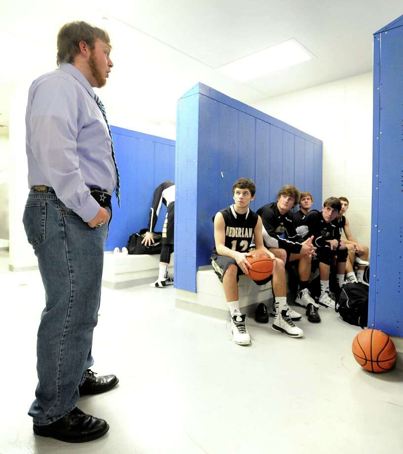 Wyatt Givan is the senior student manager for the Nederland High School basketball team.  Givan has been writing pre-game speeches for most of the games since his sophomore year with belief that it helps the team win. Givan is seen here giving his speech to the Bulldogs before their win over Ozen High School on Tuesday, February 5, 2013. Photo taken: Randy Edwards/The Enterprise Photo: Randy Edwards