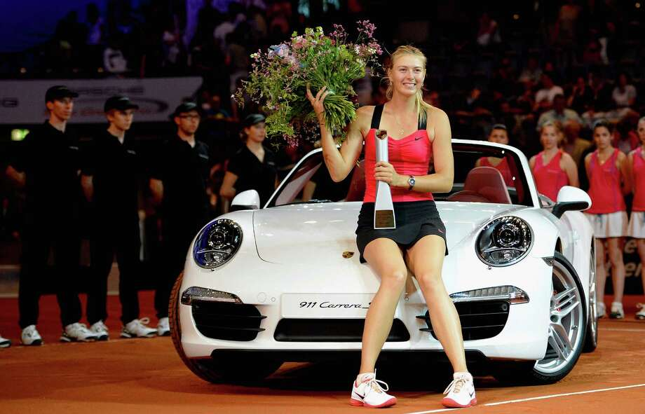 Maria Sharapova of Russia poses with her new Porsche Carrera 911 GTS after winning her final match against Victoria Azarenka of Belarus during day seven of the WTA Porsche Tennis Grand Prix at Porsche Arena on April 29, 2012 in Stuttgart, Germany. Photo: Dennis Grombkowski, Bongarts/Getty Images / 2012 Getty Images