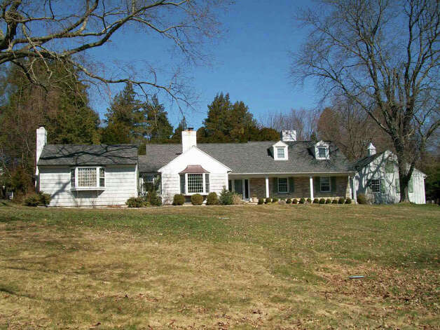 The past due taxes on this property at 138 Evergreen Hill Road, owned by John and Candace Fraser, totals $74,584. Photo: Contributed Photo / Fairfield Citizen