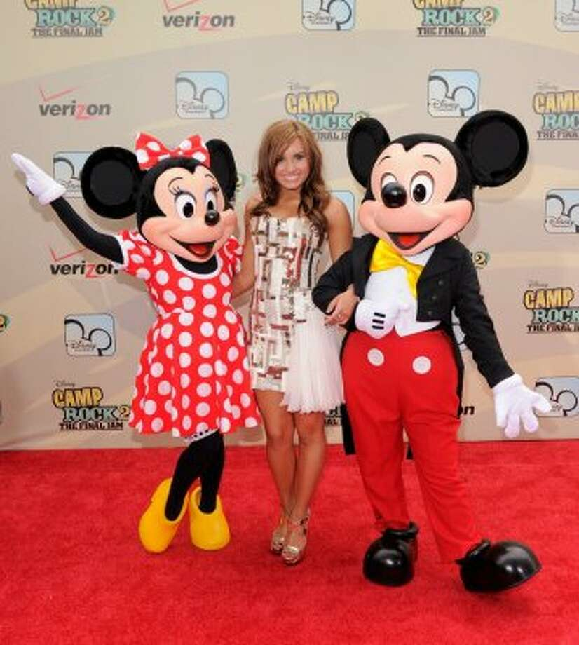"Mini Mouse, singer/actress Demi Lovato and Mickey Mouse attend the premiere of ""Camp Rock 2: The Final Jam"". (Photo by Jemal Countess/Getty Images)"