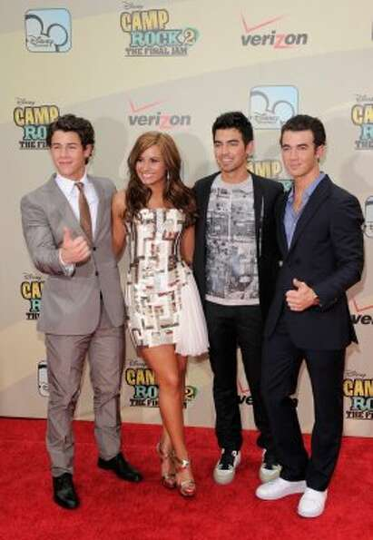 Musicians Nick Jonas, Demi Lovato, Joe Jonas and Kevin Jonas attend the premiere of