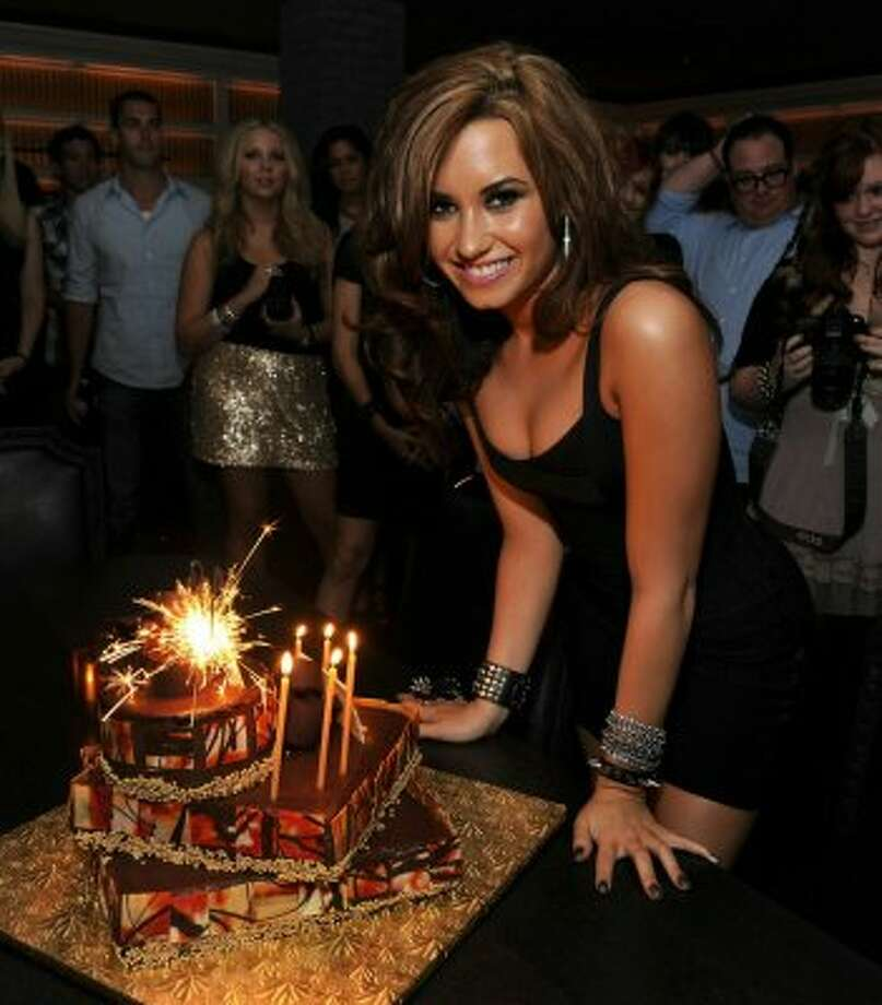 Demi Lovato with birthday cake at her18th birthday party in 2010 in New York City. (Photo by Dimitrios Kambouris/Getty Images for Full Picture)