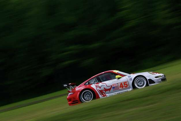 Johannes van Overbeek and Jorg Bermeister drive the Flying Lizard Motorsports Porsche 911 GT3 RSR during practice for the American Le Mans Series Northeast Grand Prix on July 6, 2007 at Lime Rock Park in Lakeville, Connecticut. Photo: Nick Laham, Getty Images / 2007 Getty Images