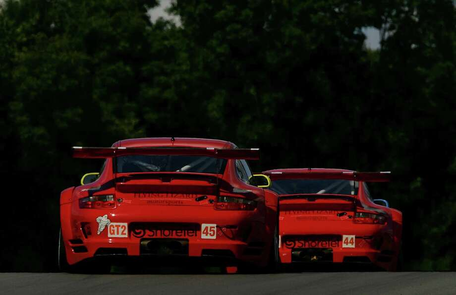 The #44 and #45 Flying Lizard Porsche 911 GT3 RSR driven by Seth Neiman and Jorg Bergmeister during practice for the American Le Mans Series Acura Sports Car Challenge on July 20, 2007 at the Mid-Ohio Sports Car Course in Lexington, Ohio. Photo: Darrell Ingham, Getty Images / 2007 Getty Images