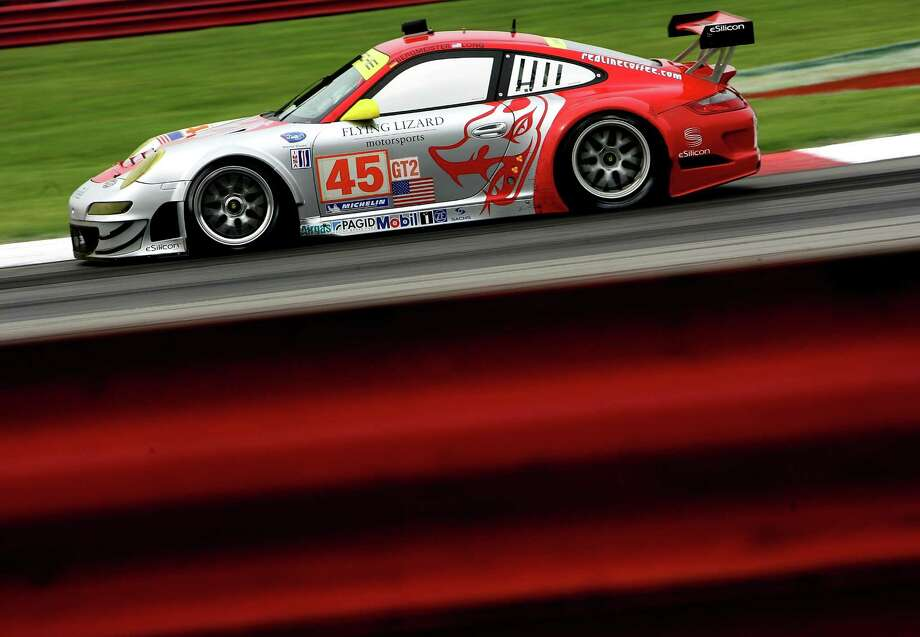 Joerg Bergmeister drives the #45 GT2 Flying Lizard Motorsports Porsche 911 RSR during the American Le Mans Series Acura Sports Car Challenge on August 8, 2009 at the Mid-Ohio Sports Car Course in Lexington, Ohio. Photo: Darrell Ingham, Getty Images / 2009 Getty Images