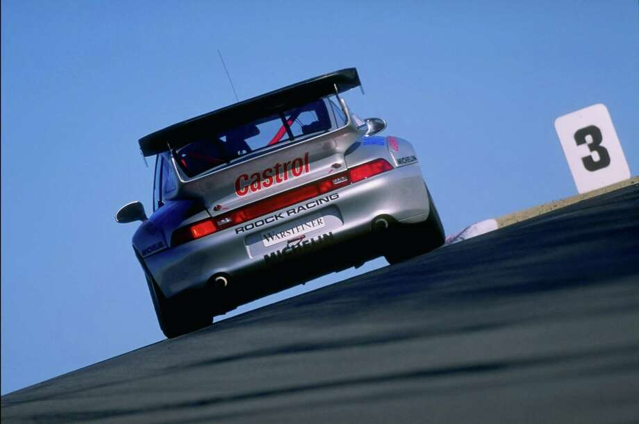 A Porsche 911 GT2 during the Visa FIA GT race at the Laguna Seca Raceway in Monterey, California IN 1997. Photo: David Taylor, Getty Images / Getty Images North America