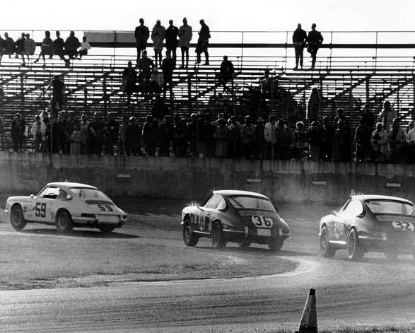 The Porsche 911T of Peter Gregg and Sten Axelsson (No. 59) leads the Porsche 911 of Wilbur Pickett/Bill Bean/Bill Bencker (No. 36) and the Porsche 911 of Jack Ryan and Pete Harrison (No. 32) during the 24 Hours of Daytona at Daytona International Speedway in 1968. Photo: RacingOne, Getty Images / 2011 RacingOne