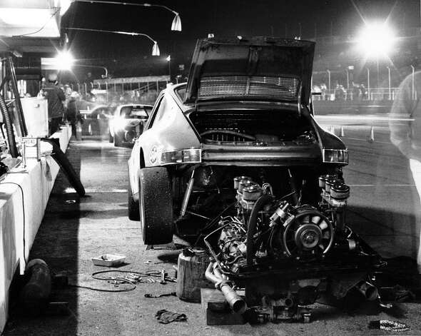 A Porsche 911 undergoes some major repair work on pit road during the 24 Hours of Daytona at Daytona International Speedway in 1971. Photo: RacingOne, Getty Images / 2011 RacingOne