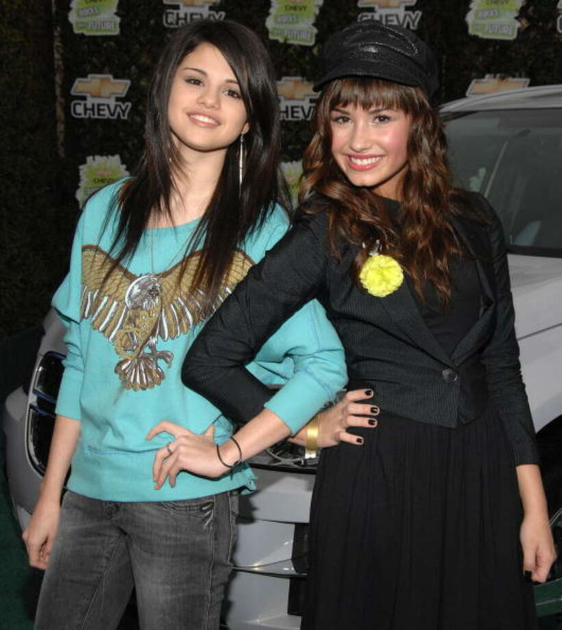Actresses Selena Gomez and Demi Lovato  at the Walt Disney Studios in 2008. (Photo by: Jean-Paul Aussenard/Wireimage) Photo: Jean-Paul Aussenard, Getty / 2008  Jean-Paul Aussenard