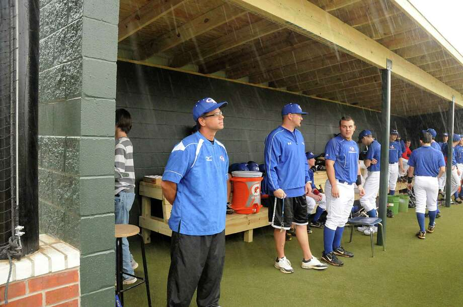 Oak Ridge baseball coach Mike Pirtle, left, looks out from the new home team dugout at the school's renovated baseball field. Photo: David Hopper, Freelance / freelance