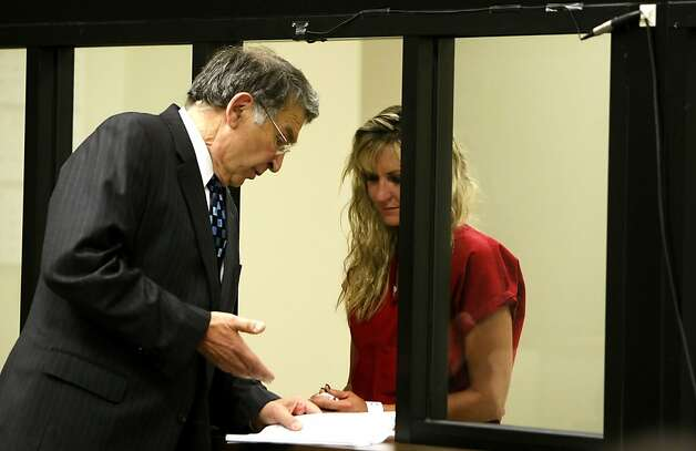 Christine Shreeve Hubbs listens to her attorney, Jules Bonjour, as she is arraigned for the alleged sexual assault of two boys in 2011 at the Gale-Schenone Hall of Justice in Pleasanton. Photo: Lacy Atkins, The Chronicle