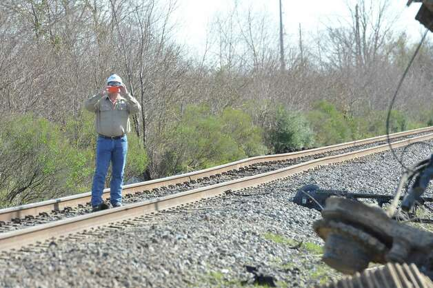 As officials document the scene, a piece of bent track rail can be seen from the crossing. The Jefferson County Sheriff's Office and Union Pacific Railroad officials are at the scene of an accident on U.S. 90 in the area of China, where a train struck a loaded  18-wheeler. There is one reported death from the crash and the wreck happened at about 8 a.m. as the 18-wheeler with three construction workers were headed to a job site. The truck's trailer got stuck on the tracks, and two men tried to free the trailer while the third remained in the truck. The train struck the truck, killing one of the men outside the truck. The man inside the truck was taken by medical helicopter to Christus St. Elizabeth Hospital and is currently in critical condition. The third man was not injured.  Attempts to avoid debris in the road by passing vehicles resulted in a second wreck with two other vehicles. There were no injuries from that wreck.    Dave Ryan/The Enterprise
