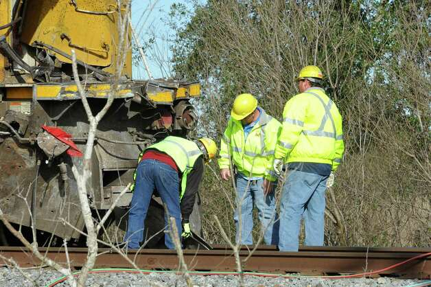 Officials look over the damaged derailed engine that hit the trailer. The Jefferson County Sheriff's Office and Union Pacific Railroad officials are at the scene of an accident on U.S. 90 in the area of China, where a train struck a loaded  18-wheeler. There is one reported death from the crash and the wreck happened at about 8 a.m. as the 18-wheeler with three construction workers were headed to a job site. The truck's trailer got stuck on the tracks, and two men tried to free the trailer while the third remained in the truck. The train struck the truck, killing one of the men outside the truck. The man inside the truck was taken by medical helicopter to Christus St. Elizabeth Hospital and is currently in critical condition. The third man was not injured.  Attempts to avoid debris in the road by passing vehicles resulted in a second wreck with two other vehicles. There were no injuries from that wreck.    Dave Ryan/The Enterprise