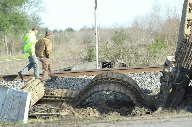The tracks of the construction equipment that was on the trailer, lays on the ground near the tracks. The Jefferson County Sheriff's Office and Union Pacific Railroad officials are at the scene of an accident on U.S. 90 in the area of China, where a train struck a loaded  18-wheeler. There is one reported death from the crash and the wreck happened at about 8 a.m. as the 18-wheeler with three construction workers were headed to a job site. The truck's trailer got stuck on the tracks, and two men tried to free the trailer while the third remained in the truck. The train struck the truck, killing one of the men outside the truck. The man inside the truck was taken by medical helicopter to Christus St. Elizabeth Hospital and is currently in critical condition. The third man was not injured.  Attempts to avoid debris in the road by passing vehicles resulted in a second wreck with two other vehicles. There were no injuries from that wreck.    Dave Ryan/The Enterprise