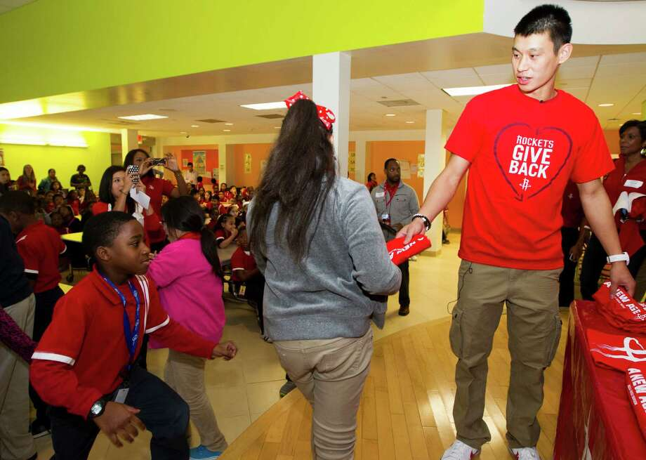 Jeremy Lin gives T-shirts to Harmony School of Ingenuity students in thanks for their participating in a drive that collected 17,000-plus items for needy families. Photo: J. Patric Schneider, Freelance / © 2012 Houston Chronicle