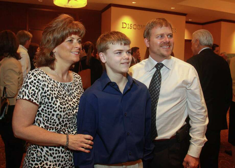 Sonja and Todd Burpo, and their son, Colton Photo: Gary Fountain, Freelance / Copyright 2013 Gary Fountain.