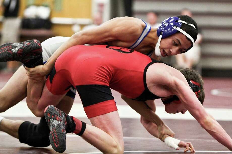 Ludlowe's Ben Batulanon wrestles during this weekend's Class L meet in Bristol. Photo: Contributed Photo