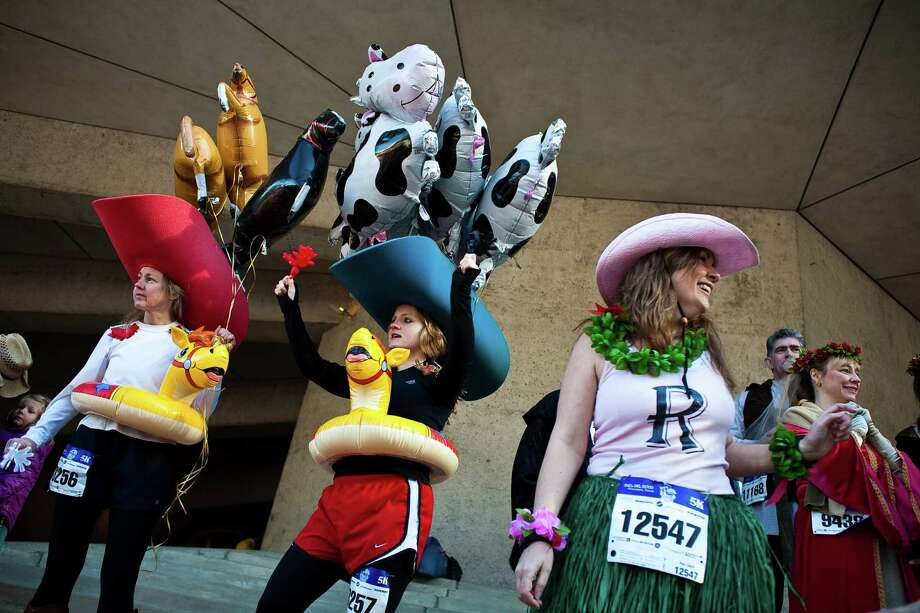 Feb. 27, 2010 -  Costumed runners yuck it up before as many as 13,000 runners participated in the Conoco Rodeo Run Feb. 27, 2010 in Houston. The run, which kicks off the Houston Livestock Show and Rodeo parade, took runners from Bayou Place through the streets of downtown to the finish just past Minute Maid Park on Texas Avenue. There was a 10K and 5K race. Photo: Eric Kayne, For The Chronicle / Eric Kayne