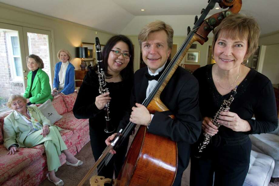 Anne Carsey, from left, Suzanne Lyons and Fran Sampson's plan to help the River Oaks Chamber Orchestra ultimately helped a number of musicians, including Maiko Sasaki, Erik Gronfor and Spring Hill. Photo: Brett Coomer, Houston Chronicle / © 2013 Houston Chronicle