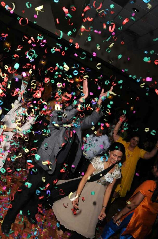 Confetti poppers shower dancers with paper confetti at the Bollywood Masti on Sat. Dec. 26, 2009 at the Portuguese Cultural Center in Danbury. Photo: Lisa Weir / The News-Times