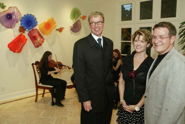 Artspace President Kelley Lindquist (L) Claudia Williamson (C) and Joe Nelson (R) at Nelson's museum district home Wednesday Sept. 22, 2004 to celebrate groundbreaking on the Jeff Davis Hospital project.  The mission of Artspace Projects is to create, foster and preserve affordable space for artists and arts organizations. We pursue this mission through development projects, asset management activities, consulting services, and community-building activities that serve artists and arts organizations from a variety of economic circumstances. By creating this space, Artspace supports the continued professional growth of artists and enhances the cultural and economic vitality of the surrounding community. Photo: Richard Carson / ARTSPACE