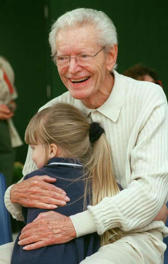Caroline Culberson, 4, hugs Dr. John P. McGovern at the new John P. McGovern Children's Zoo. Photo: Melissa Phillip, Staff / Houston Chronicle