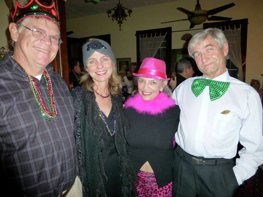 Bill Hoover (from left) takes a break from dancing the tango at a Mardi Gras milonga with wife, Alicia Hoover, hostess Kathleen Trenchard and Lajos Pongracz. Photo: Nancy Cook-Monroe, For The Express-News