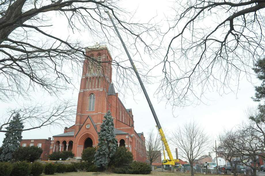 A large crane is set up alongside the former St. Patrick's Church as workers removed a large bell from the tower on Tuesday, Feb. 19, 2013, in Watervliet, NY.  (Paul Buckowski / Times Union) Photo: Paul Buckowski / 00021226A