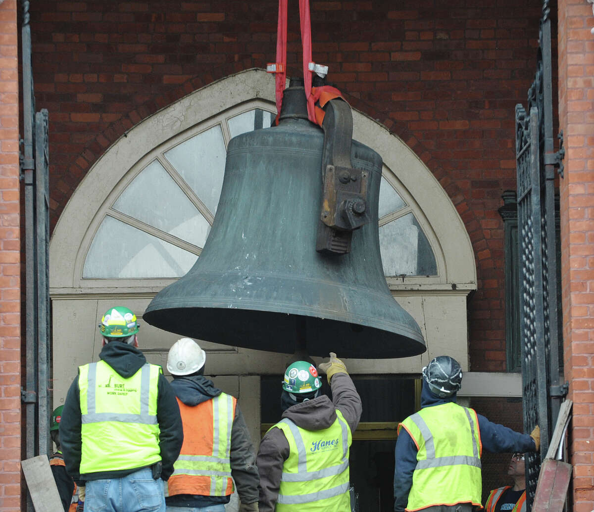 A large bell is lowered by a crane as workers removed the bell from the tower of the former St. Patrick's Church building on Tuesday, Feb. 19, 2013, in Watervliet, NY. (Paul Buckowski / Times Union)