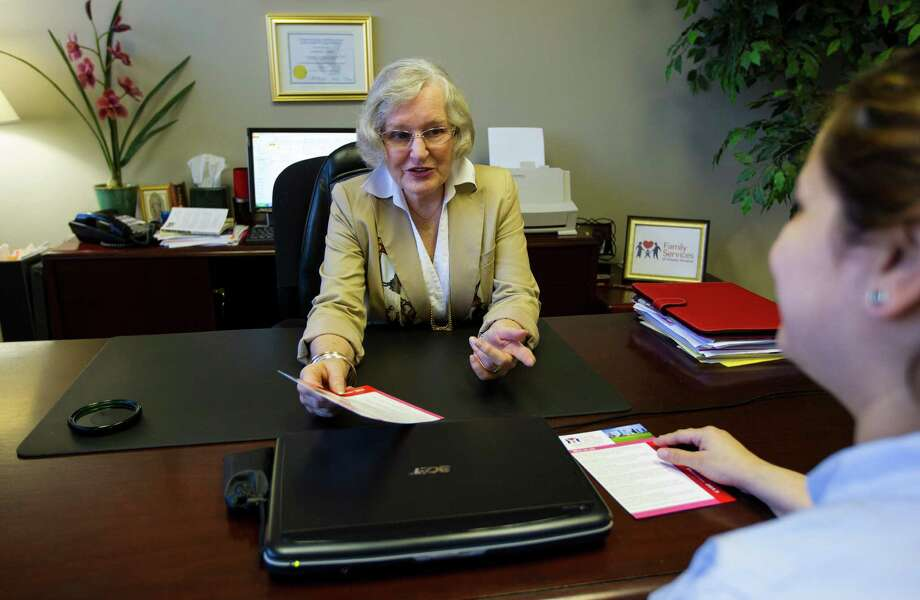 Connie Clancy, director of Parent Resources Services at the Family Services of Greater Houston, talks with Yanira Montes, administrative assistant for the Houston Marriage Project. Photo: Karen Warren, Staff / © 2013 Houston Chronicle