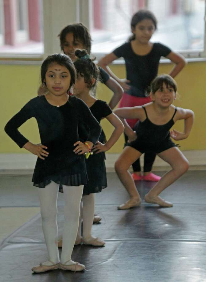 Bella Magana, left, Ophelia Morin, right, Mary Contreras, back right, and others study ballet at Multicultural Education and Counseling Through the Arts. Photo: Melissa Phillip, Staff / © 2013 Houston Chronicle