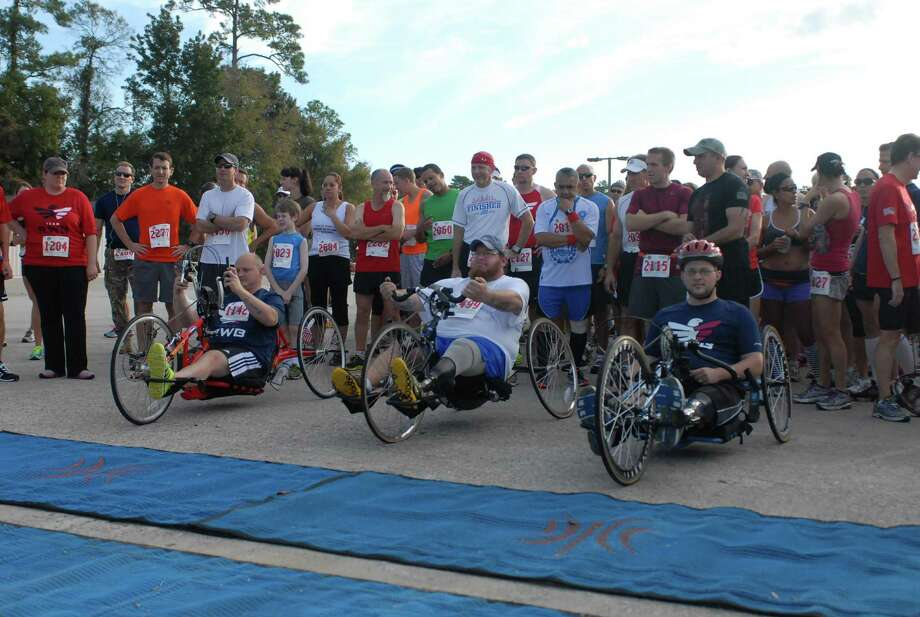 The wheelchair division in Team Red White and Blue's annual Veterans Day race prepares to leave the start line. Photo: Courtesy Team RWB