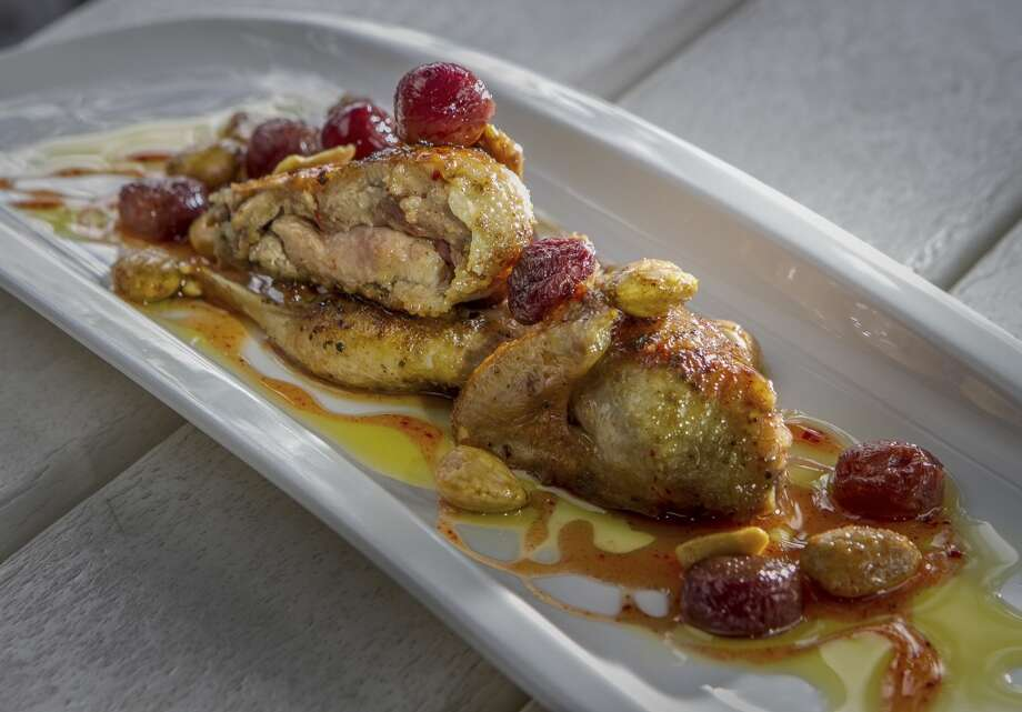 ...It's in a la plancha section along with another excellent dish - quail ($12) scented with lavender and drizzled with honey and sherried grapes.