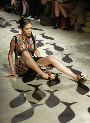 A model falls on the catwalk during a show for Italian fashion house Prada as part of the women's Spring/Summer 2009 ready-to-wear collections of the fashion week in Milan on September 23, 2008. Photo: STR, AFP/Getty Images / 2008 AFP