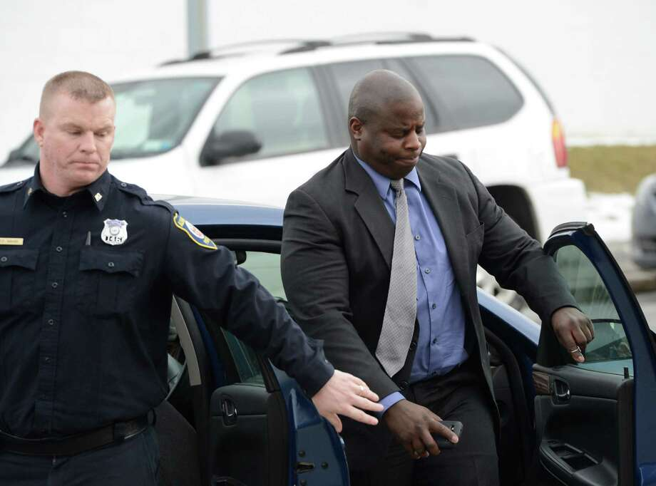 Veteran Albany Police Officer Max Etienne, right arrives at the City Court building at 1 Morton Avenue Monday afternoon, Feb. 19, 2013 in Albany, N.Y., for his arraignment on DWI charges for an incident occurring early Sunday morning in Albany. (Skip Dickstein/Times Union) Photo: SKIP DICKSTEIN / 00021219A