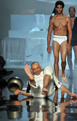 Model falls on  the runway during the Jean-Paul Gaultier Fashion show Menswear, show as part of Paris Menswear Fashion Week Spring/Summer 2011 at on June 24, 2010 in Paris, France. Photo: Dominique Charriau, WireImage / 2010 Dominique Charriau