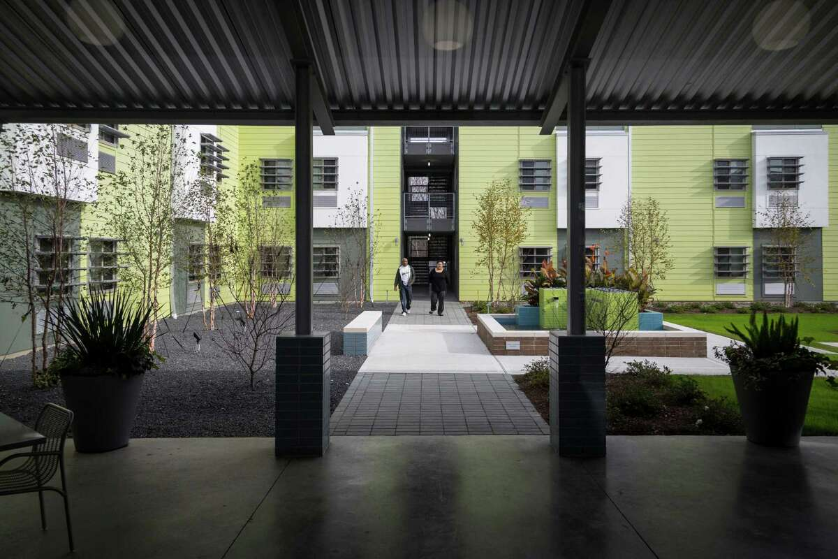 The courtyard at 4415 Perry, a 160-unit single room occupancy apartment complex for low-income residents, is an inviting oasis. The project was built by the nonprofit New Hope Housing Inc.