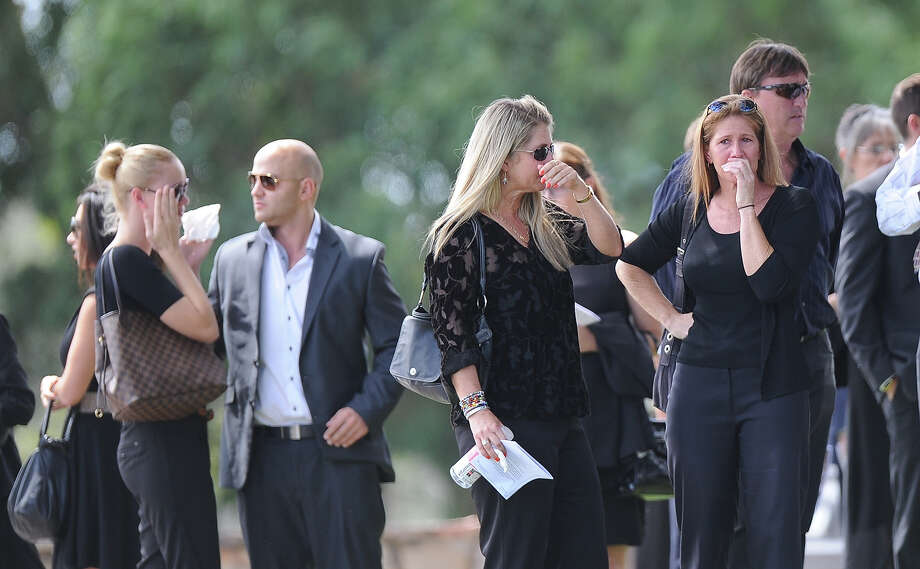 "Relatives and friends of the late South African model Reeva Steenkamp mourn for the funeral ceremony at the crematorium building in Port Elizabeth on February 19, 2013 after Steenkamp, 29, was shot four times in the early hours of February 14, 2013 by a 9mm pistol owned by South African sporting hero Oscar Pistorius. South African prosecutors on Tuesday told a bail hearing that Oscar Pistorius was guilty of ""premeditated murder"" in the Valentine's Day killing of his model girlfriend at his upscale home. Photo: ALEXANDER JOE, AFP/Getty Images / 2013 AFP"
