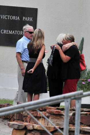 Michael Steenkamp, family members and friends gather for Reeva Steenkamp's memorial on February 19, 2013 in Port Elizabeth, South Africa. Steenkamp was allegedly murdered by boyfriend, Oscar Pistorius on February 14, 2013. Pistorius, who has been charged with the murder, is appearing in court today for his bail hearing. Steenkamp's memorial is being held at the The Victoria Park Crematorium. Photo: Gallo Images, Getty Images / 2013 Gallo Images (PTY) LTD