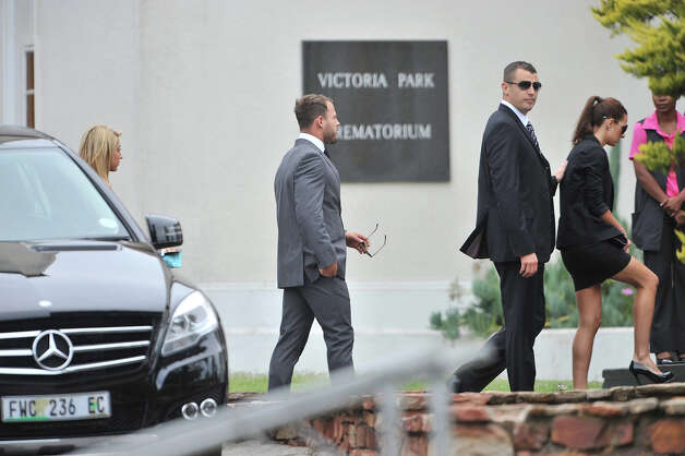 Justin Divaris ans Francios Hougaard at  Reeva Steenkamp's memorial service at the Victoria Park Crematorium on February 19, 2013 in Port Elizabeth, South Africa. Steenkamp was allegedly murdered by boyfriend, Oscar Pistorius on February 14, 2013. Pistorius, who has been charged with the murder, is appearing in court today for his bail hearing. Photo: Gallo Images, Getty Images / 2013 Gallo Images (PTY) LTD