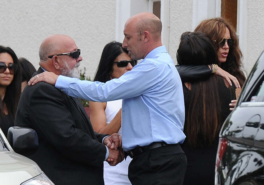 "Father of the late South African model Reeva Steenkamp Barry Steenkamp (2L) arrives at the crematorium building in Port Elizabeth on February 19, 2013 after Steenkamp, 29, was shot four times in the early hours of February 14, by a 9mm pistol owned by South African sporting hero Oscar Pistorius. South African prosecutors on Tuesday told a bail hearing that Oscar Pistorius was guilty of ""premeditated murder"" in the Valentine's Day killing of his model girlfriend at his upscale home.= Photo: ALEXANDER JOE, AFP/Getty Images / 2013 AFP"