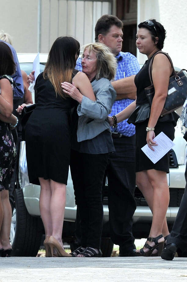 June Steenkamp, Reeva's mother, is comforted as she arrives at Reeva's memorial on February 19, 2013 in Port Elizabeth, South Africa. Steenkamp was allegedly murdered by boyfriend, Oscar Pistorius on February 14, 2013. Pistorius, who has been charged with the murder, is appearing in court today for his bail hearing. Steenkamp's memorial is being held at The Victoria Park Crematorium. Photo: Gallo Images, Getty Images / 2013 Gallo Images (PTY) LTD