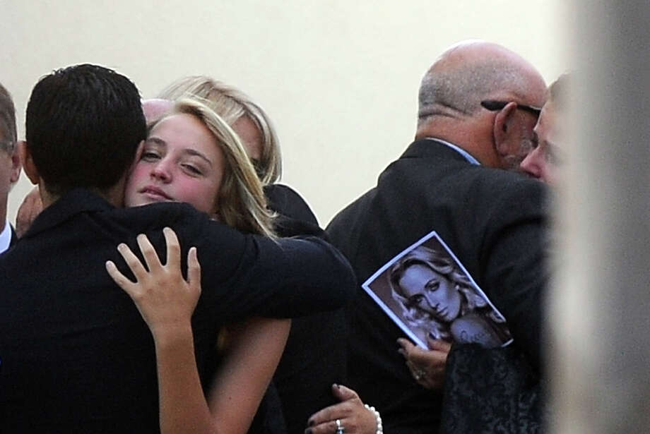 "Relatives and friends of the late South African model Reeva Steenkamp mourn on February 19, 2013 during her funeral at a crematorium in Port Elizabeth. Steenkamp, 29, was shot four times in the early hours of February 14, 2013 by a 9mm pistol owned by South African sporting hero Oscar Pistorius. South African prosecutors said at a bail hearing on February 19 that Pistorius was guilty of ""premeditated murder"" in the Valentine's Day killing of his model girlfriend at his upscale home. Photo: ALEXANDER JOE, AFP/Getty Images / 2013 AFP"