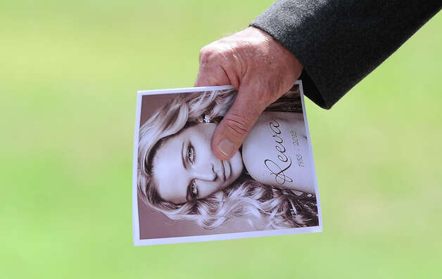 "A relative of late South African model Reeva Steenkamp holds the funeral program upon arriving at the crematorium building in Port Elizabeth on February 19, 2013. The 29-year-old law graduate and cover girl was gunned down four times on February 14, 2013 at the upmarket Pretoria home of the Olympic and Paralympic star Oscar Pistorius. South African prosecutors on February 19 told a bail hearing that Oscar Pistorius was guilty of ""premeditated murder"" in the Valentine's Day killing of his model girlfriend at his upscale home. Photo: ALEXANDER JOE, AFP/Getty Images / 2013 AFP"