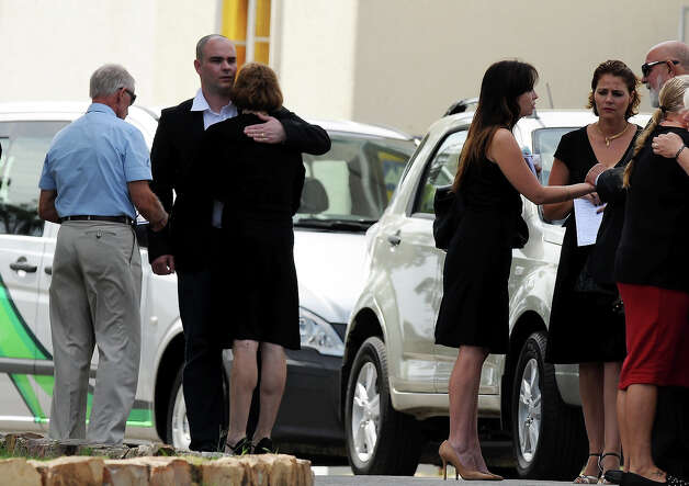 Dam Steenkamp , Reeva's stepbrother, is comforted as he arrives at Reeva's memorial on February 19, 2013 in Port Elizabeth, South Africa. Steenkamp was allegedly murdered by boyfriend, Oscar Pistorius on February 14, 2013. Pistorius, who has been charged with the murder, is appearing in court today for his bail hearing. Steenkamp's memorial is being held at The Victoria Park Crematorium. Photo: Gallo Images, Getty Images / 2013 Gallo Images (PTY) LTD