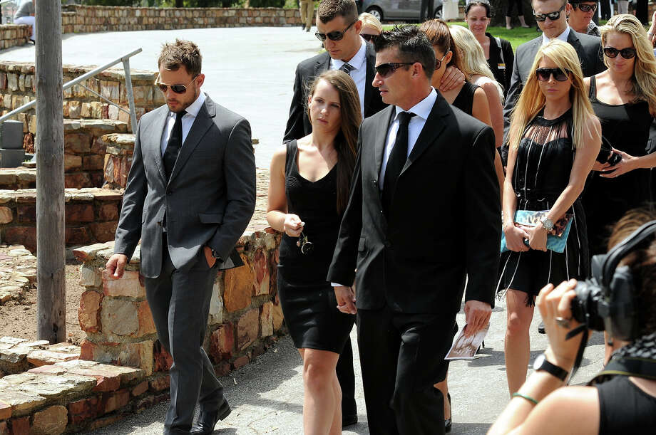 Francois Hougaard and Justin Divaris leave Reeva's memorial on February 19, 2013 in Port Elizabeth, South Africa. Steenkamp was allegedly murdered by boyfriend, Oscar Pistorius on February 14, 2013. Pistorius, who has been charged with the murder, is appearing in court today for his bail hearing. Steenkamp's memorial is being held at The Victoria Park Crematorium. Photo: Gallo Images, Getty Images / 2013 Gallo Images (PTY) LTD